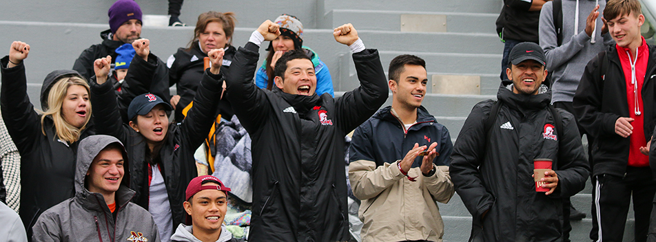 Fan Club: Fans cheer as the SAIT Trojans women's soccer team scores their first goal of the game against the Medicine Hat Rattlers in Calgary. The Trojans claimed victory with a final score of 2Ð0. (Photo by Parker Crook/The Press)