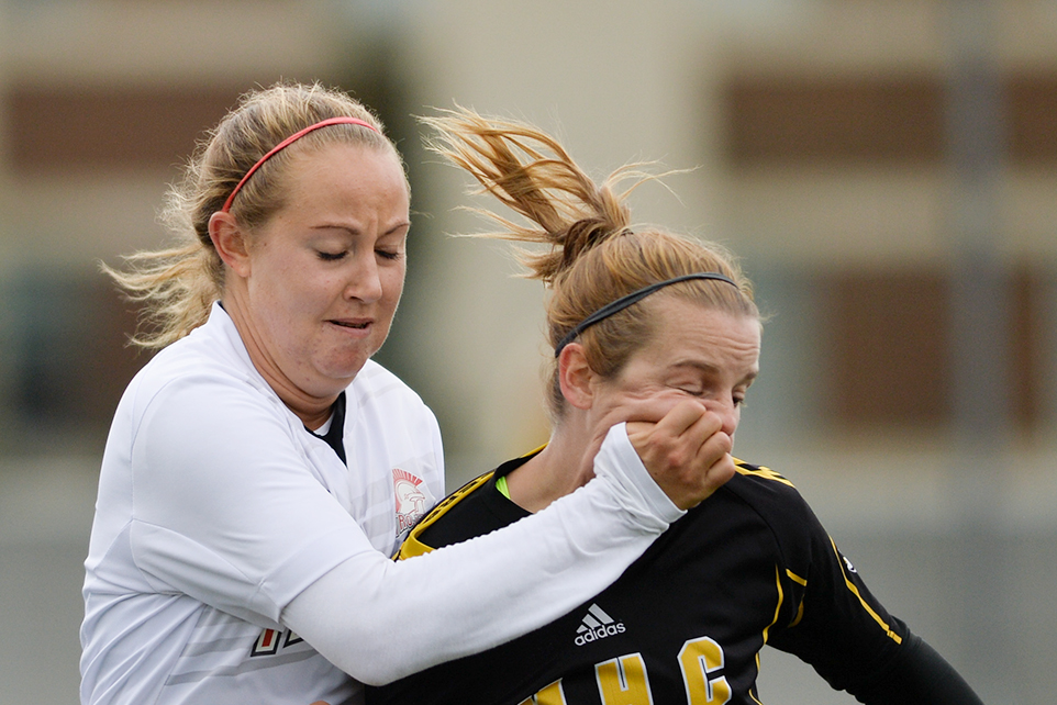 SAIT Trojans women's soccer midfield Kaitlyn Silcox, left, smashes the face of Medicine Hat Rattlers forward Kaity Letwiniuk during soccer action at SAIT's Cohos Commons Field in Calgary on Sunday, Sept. 11, 2016. The Trojans took the Alberta Colleges Athletics Conference regular season game 2-0. (Photo by Ashley Orzel/The Press)