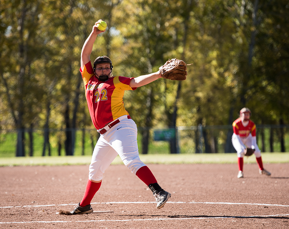 CATCHYPHRASE:University of Calgary Dino's pitcher, Haley Acton pitches during a double header match against the SAIT Trojans in Drumheller. The Dino's won by a score of 12-1. (Photo by Terri Huxley/The Press)
