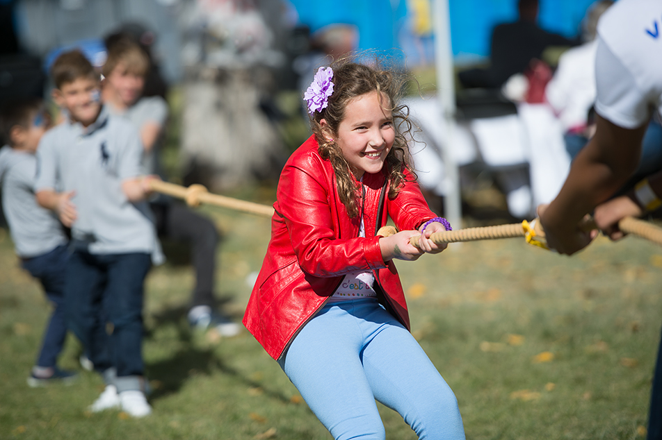 Tug-a-War: A child competes in a tug-of-war competition during the 18th annual Calgary Greek Festival at the Hellenic Community Centre. The family-friendly event marks the changing of the seasons in the Greek community. (Photo by Ashley Orzel/The Press)