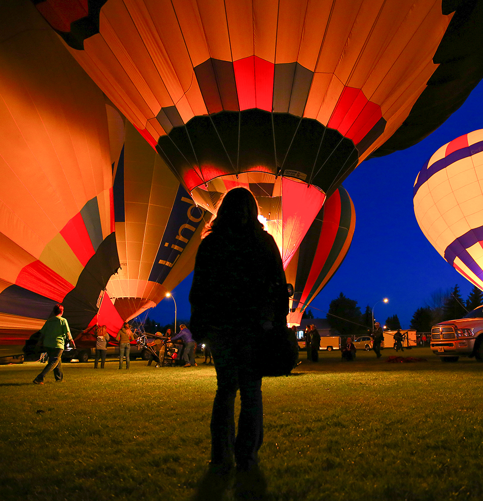 Big Balloons: Spectators gather to watch the Heritage Inn International Balloon Festival in High River. The event features balloons from all around the world and are set up in a launch area at sunset, giving off a spectacular glow for people to enjoy. (Photo by Dawn Gibson/ The Press)