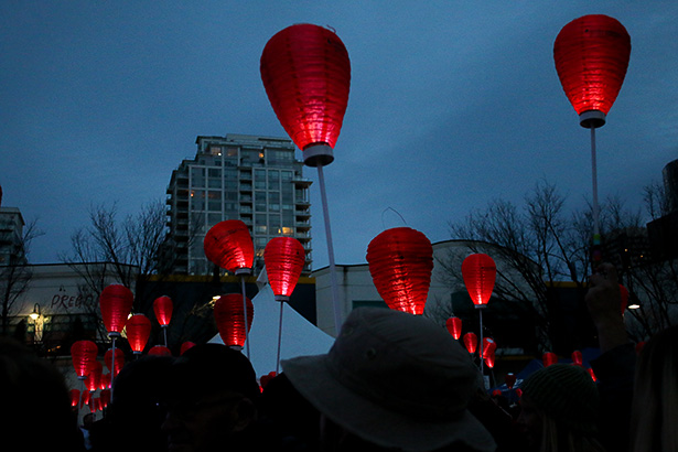 High Hopes: Supporters raise their red lanterns high in Calgary to honour those battling blood cancer on Saturday, Oct. 15, 2016. Thousands filled Eau Claire Market for the Light the Night fundraiser for the Leukemia and Lymphoma Society of Canada. (Photo by Mitch Sparks/The Press)