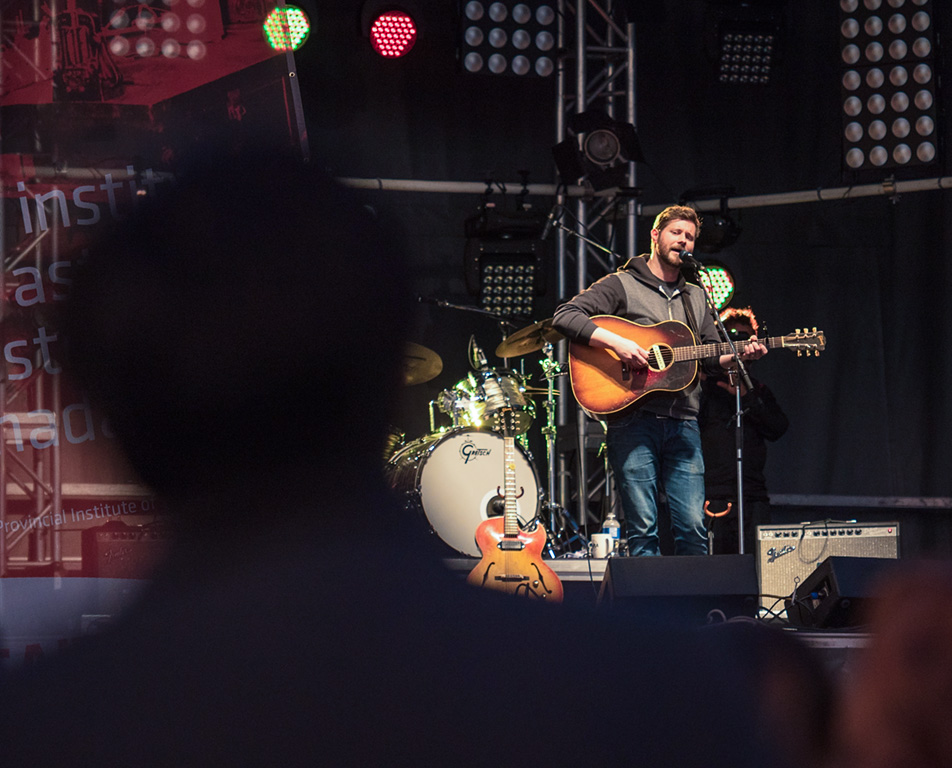 :A Little Night Music: Dan Mangan performs on a Cohos Commons Field stage. (Photo by Terri Huxley/The Press)