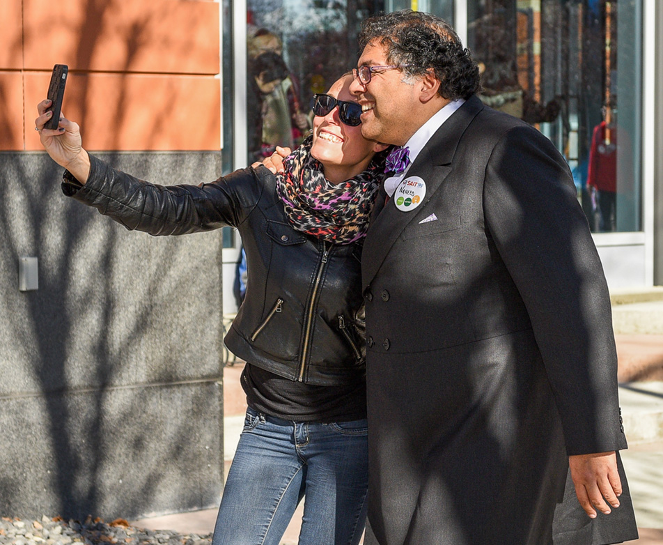 Mayoral Moment: An attendee, left, poses for a selfie with Calgary Mayor Naheed Nenshi. (Photo by Jeremy Ash/ The Press)