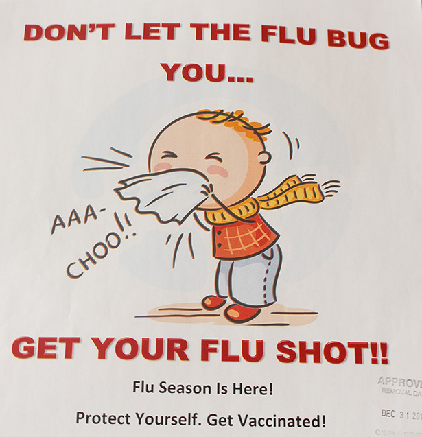 Nothing to Sneeze At: A vaccination poster hangs in the Senator Burns Building at SAIT in Calgary on Thursday, Oct. 20, 2016. SAIT Health Services advises that students get flu shots before an official outbreak occurs. (Photo by Faith Howard/The Press)