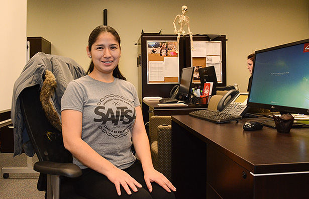 Holding the Fort: Diana Rodriduez, the Safewalk coordinator, sits at her desk inside the SAITSA main office at SAIT in Calgary on Wednesday, Oct. 26, 2016. Rodriduez has been the Safewalk coordinator since the start of the Fall 2016 semester. (Photo by Peter Shokeir/The Press)