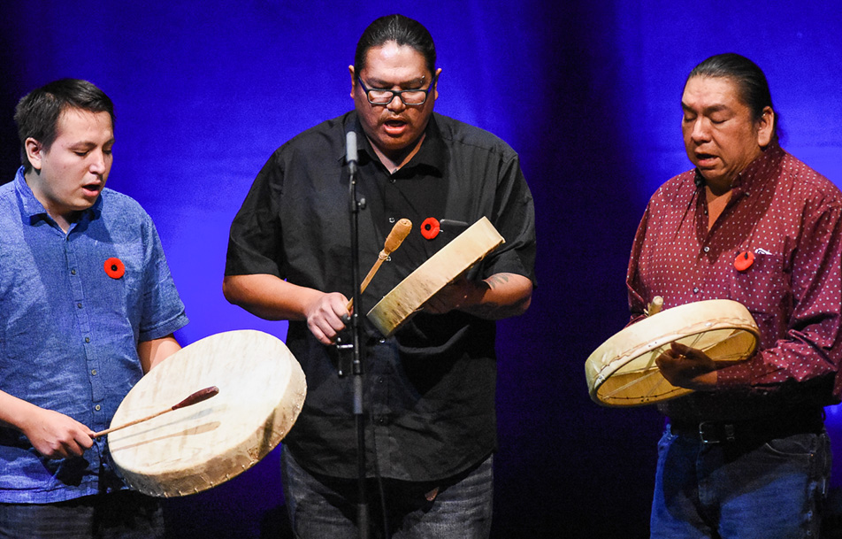 Drumming to Remember: Cole Healey, left, Herman Yellow Old Woman and Black Rider, all members of the Black Otter Singers, perform an Aboriginal honour song. (Photo by Shaleen Ladha/The Press)