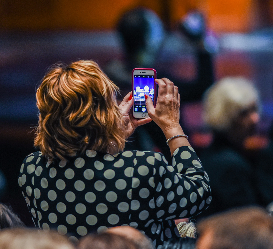 Keepsake: An attendee captures a picture of an onstage display. (Photo by Shaleen Ladha/The Press)