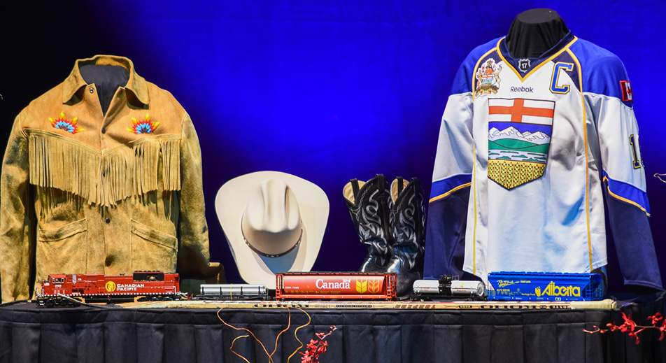 Serving Alberta: A display of objects relevant to Jim Prentice occupies a corner of the memorial stage. (Photo by Shaleen Ladha/The Press)