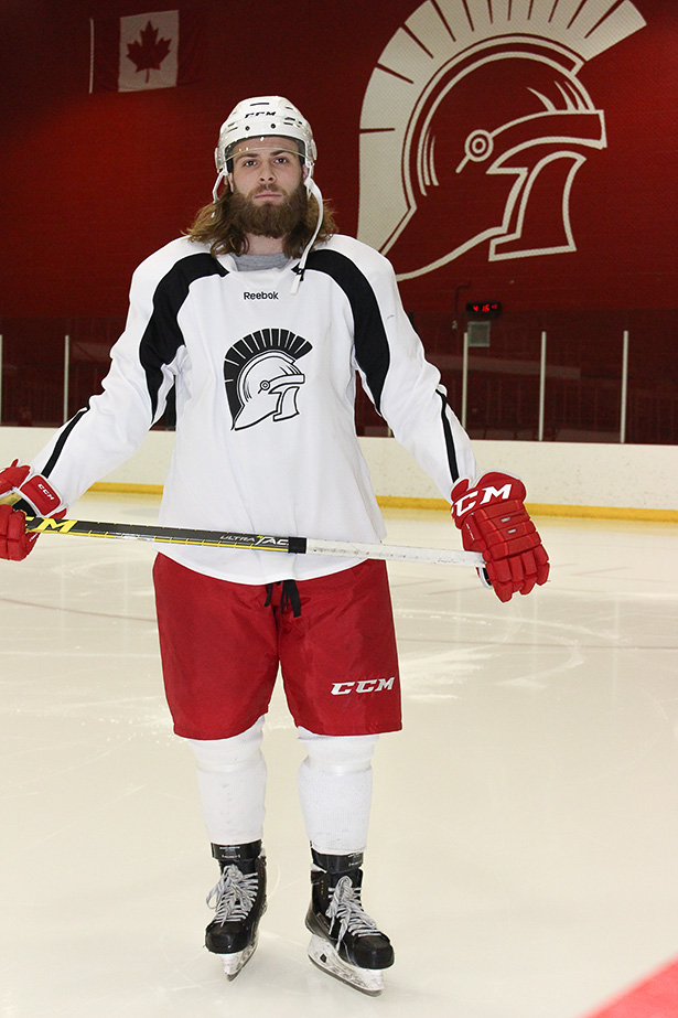 Fear the Beard:Mason Krueger poses on the ice at SAIT Arena in Calgary on Wednesday, Oct. 26, 2016. Krueger is in his first year of the graphic communications and print technology program. (Photo by Joel Griffith/The Press)