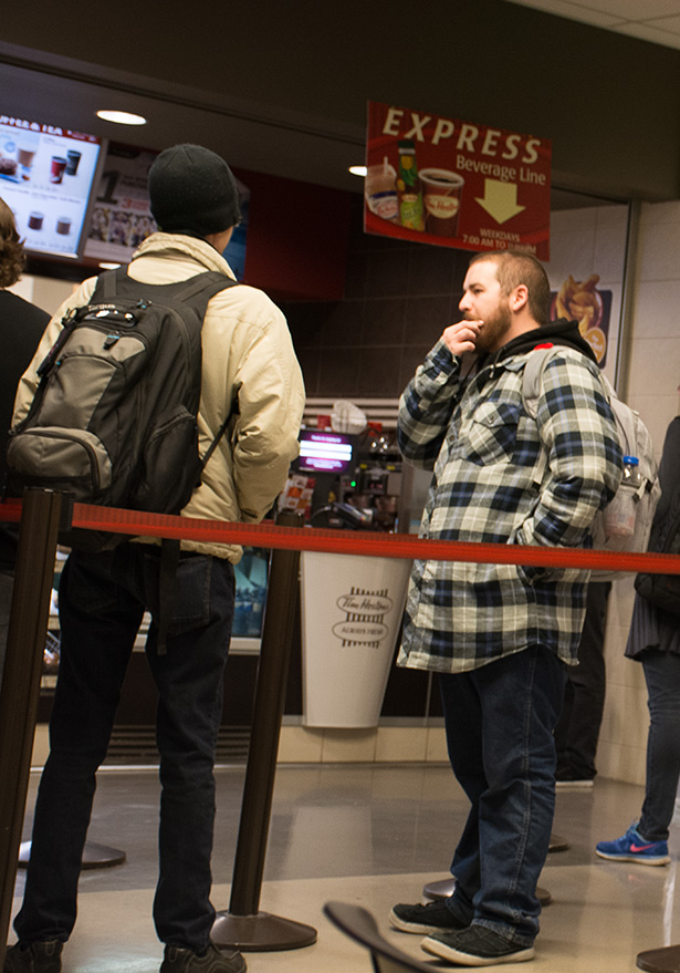 Proud Poppy:Students line up at the Tim Hortons in SAIT's Senator Burns where poppies have gone on sale in Calgary on November 2, 2016. The funds from the poppies are used to benefit veterans and their families. (Photo by Brianna Brost/The Press)