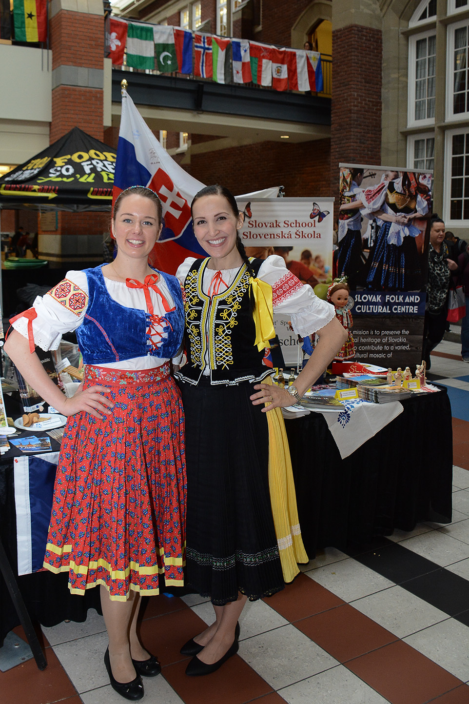 Czech-Slovak relations: Monica Heczkova and Veronica Gruszkova wear traditional outfits from their countries as they stand in front of their country's information booth in the Stan Grad building during International Education week at SAIT on Tuesday, Nov. 15. (Photo by Sean Gallagher-LeGouff SAIT Polytechnic)