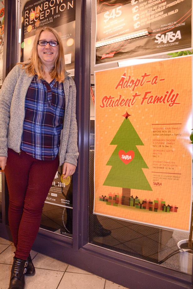 SAITSA supports family:Shona Sutherland the communications director for SATISA in Calgary on Wednesday, Nov. 16, 2016. helping the support of the Adopt-a-student family at SAIT. (Photo by Kerriene England/The Press)