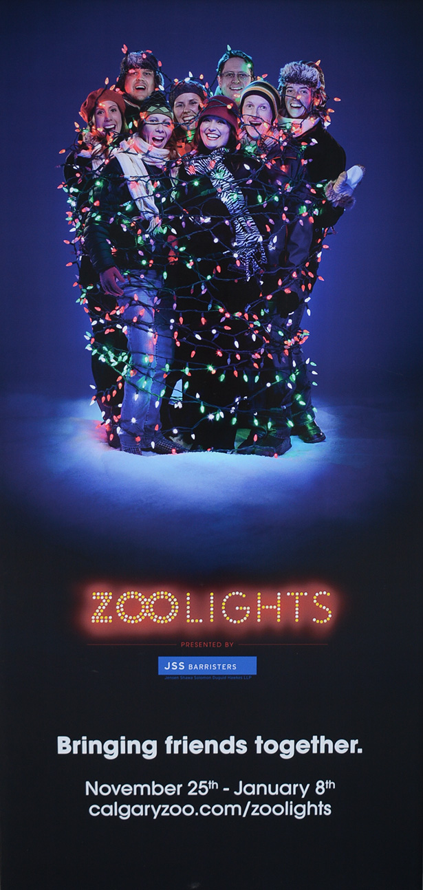 Light Em Up: Zoo Lights poster displayed at the Calgary Zoo in Calgary on Thursday, Nov. 10, 2016. The 19th annual Zoo Lights tradition begins on Nov. 25, 2016. (Photo by Lindsey Dahl/The Press)