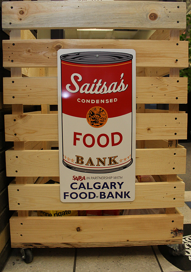 Donations: A redesigned hamper for the SAITSA Food Bank sits in front of the Resource Centre MC107 on SAIT campus in Calgary, Alberta on Thursday, Nov. 17, 2016. Students can contribute food and household items here that will go towards students in need. (Photo by Shane Weaver/The Press)