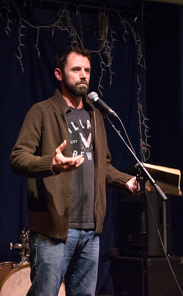 Spoken Word Slammer:Tyler Perry reading a poem from his book during the Spoken Word event held at the Wine-Ohs bar in Calgary on Monday, Nov. 28, 2016. Perry was one of the founding members of the Ink Spot Collective and captain of the slam team on 2010 (Photo by Sareenah Singh/The Press)