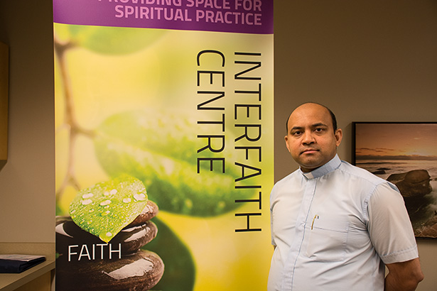 Father Figure: Father Sajo Jacob, stands in the Interfaith Centre in the Stan Grad Centre on Nov. 30, 2016. Father Jacob, representing the catholic faith, is one of many chaplains who help run the Interfaith Centre at SAIT. (Photo by Justin Schellenberg/The Press)