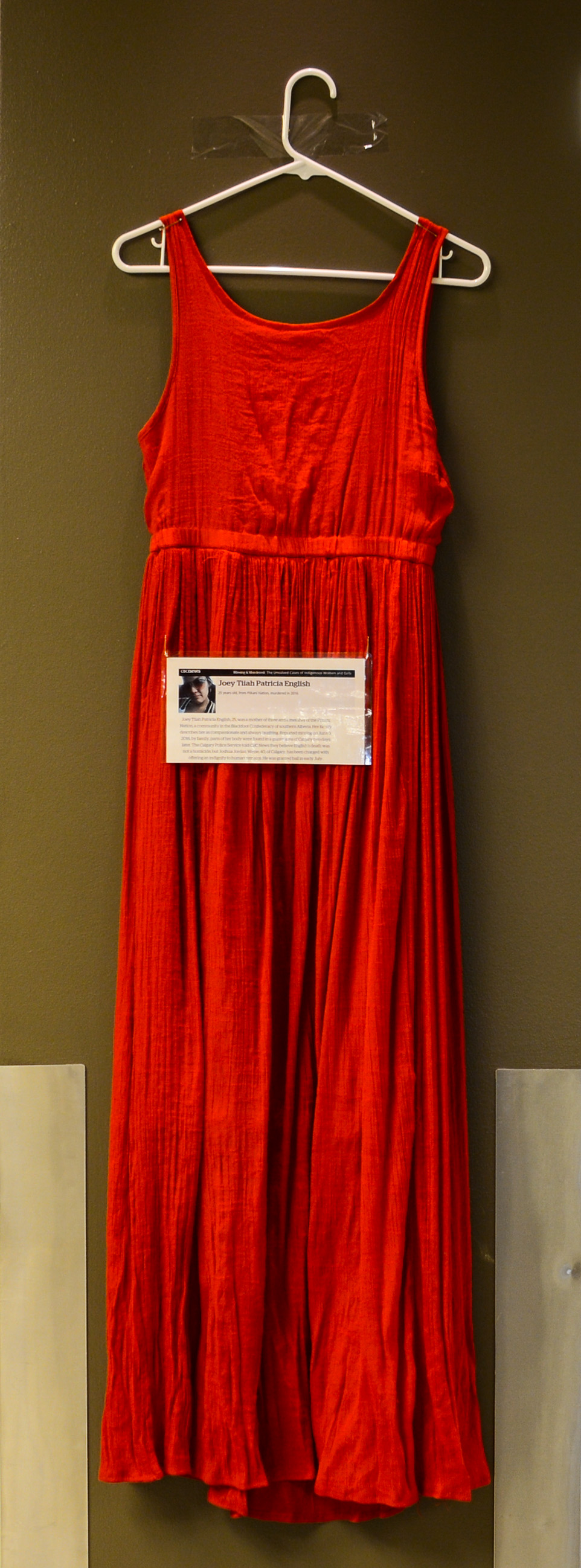 Ghosts In Red: The red dress hung in memory of Joey Tiiha Patricia English at the ground floor of SAIT's Senator Burns Building, Dec. 2, 2016. (Photo by Lucas Lyons/SAIT Polytechnic